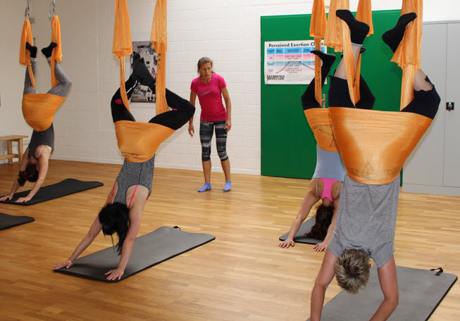 AntiGravity-Fitness, group fitness training, wheel barrow